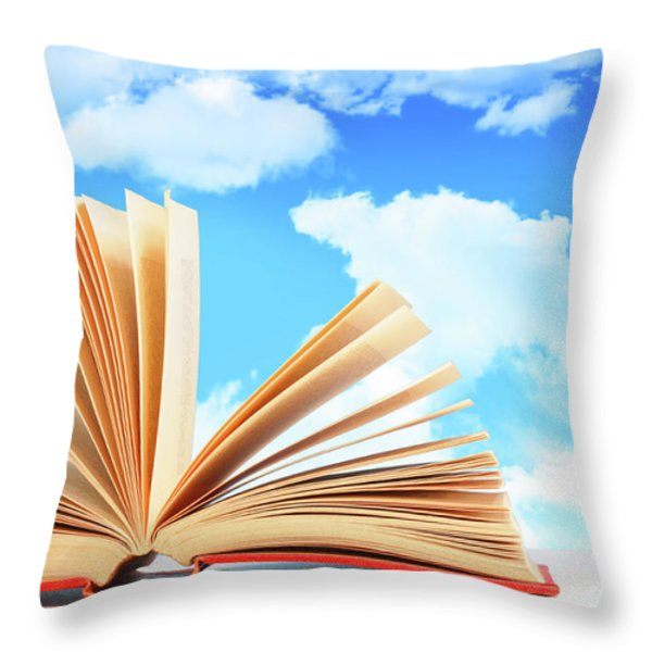 Open Book Against A Blue Sky Throw Pillow by Sandra Cunningham