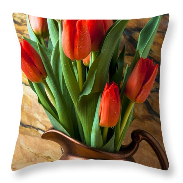 Orange tulips in copper pitcher Throw Pillow by Garry Gay