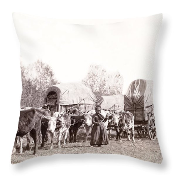 OX-DRIVEN WAGON FREIGHT TRAIN c. 1887 Throw Pillow by Daniel Hagerman