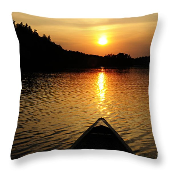 Paddling Off Into The Sunset Throw Pillow by Larry Ricker