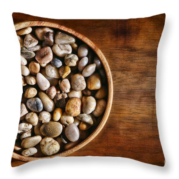 Pebbles in Wood Bowl Throw Pillow by Olivier Le Queinec