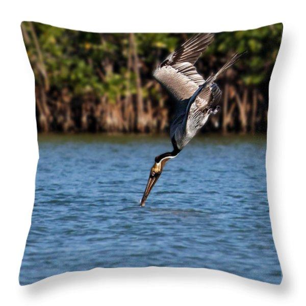 Pelican Dive Throw Pillow by Dawn Currie