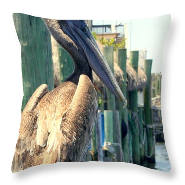Pelican On A Post Throw Pillow by Dorothy Menera