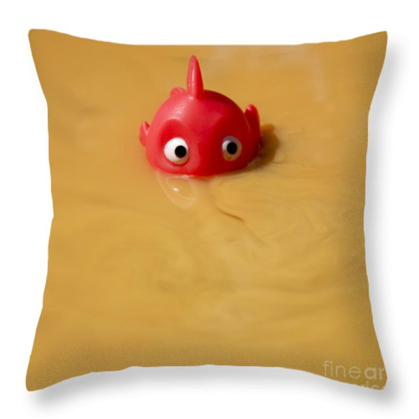 Plastic fish in some polluted water. Throw Pillow by BERNARD JAUBERT