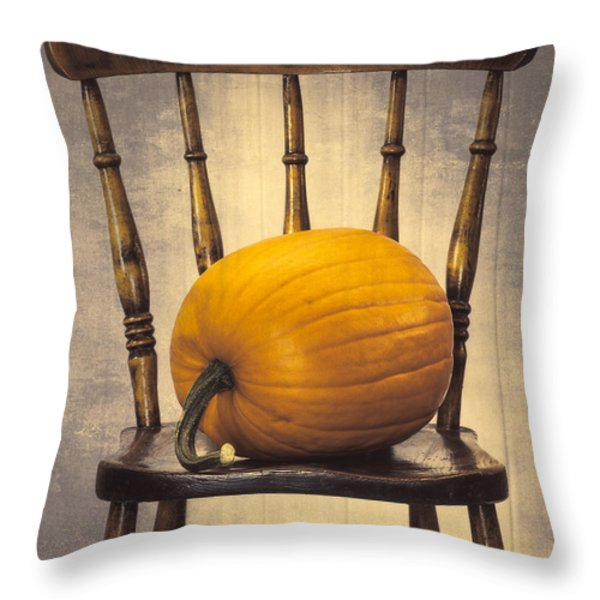 Pumpkin On Chair Throw Pillow by Amanda And Christopher Elwell