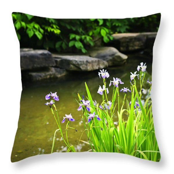 Purple irises in pond Throw Pillow by Elena Elisseeva