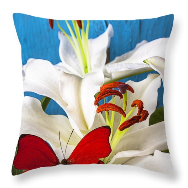 Red butterfly on white tiger lily Throw Pillow by Garry Gay