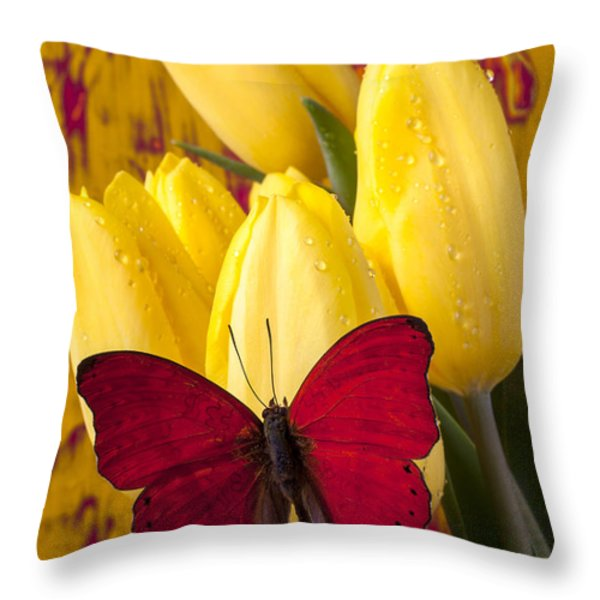 Red Butterfly Resting On Tulips Throw Pillow by Garry Gay