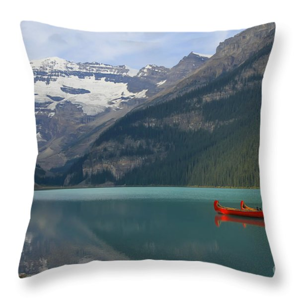 Red Canoes on Lake Louise Throw Pillow by Teresa Zieba