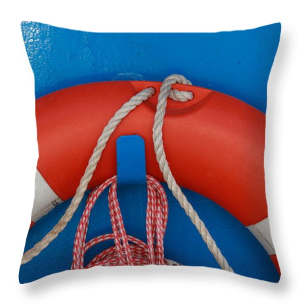 Red life belt on blue wall Throw Pillow by Intensivelight