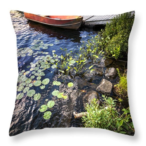 Rowboat at lake shore Throw Pillow by Elena Elisseeva