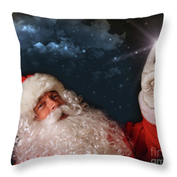 Santa pointing with magical light to the sky Throw Pillow by Sandra Cunningham
