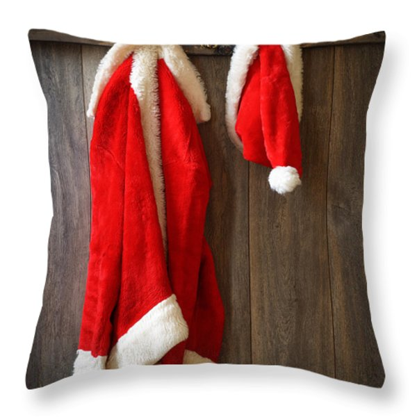 Santa's Coat Throw Pillow by Amanda And Christopher Elwell