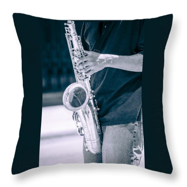 Saxophone Player On Street Throw Pillow by Carolyn Marshall