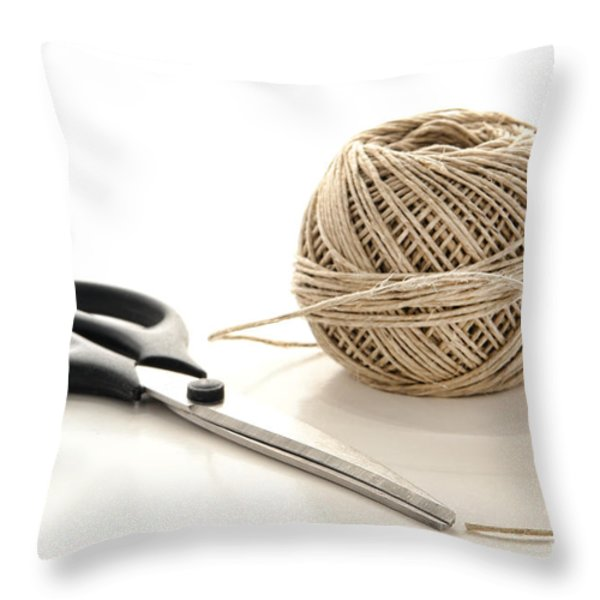 Scissors and Twine Throw Pillow by Olivier Le Queinec