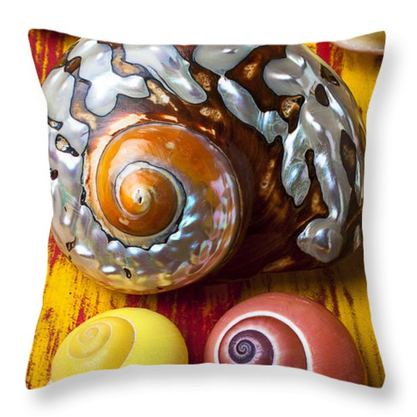 Six snails shells Throw Pillow by Garry Gay