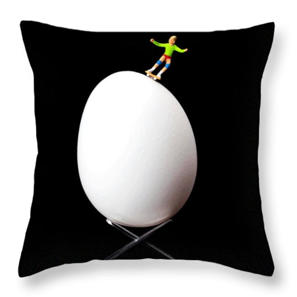 Skateboard Rolling On A Egg Throw Pillow by Paul Ge