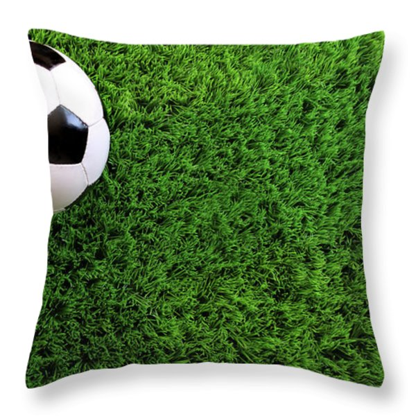 Soccer Ball On Green Grass Throw Pillow by Sandra Cunningham