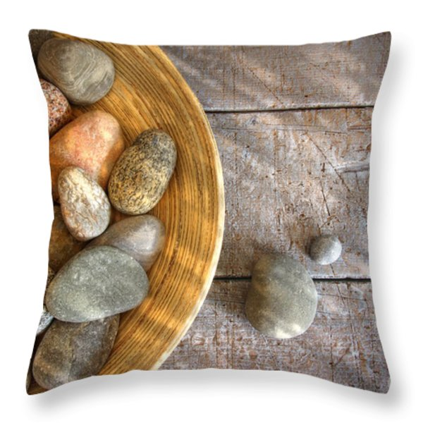 Spa rocks in wooden bowl on rustic wood Throw Pillow by Sandra Cunningham