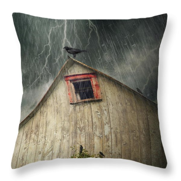 Spooky old barn with crows on a stormy night Throw Pillow by Sandra Cunningham