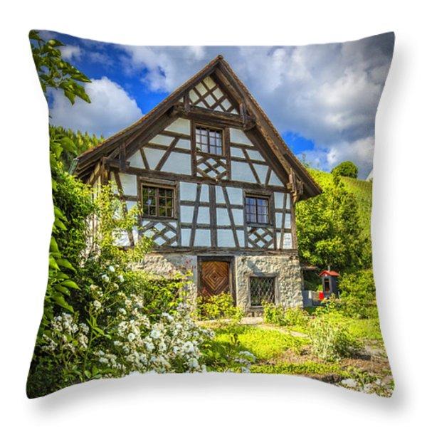 Swiss Chalet in the Garden Throw Pillow by Debra and Dave Vanderlaan
