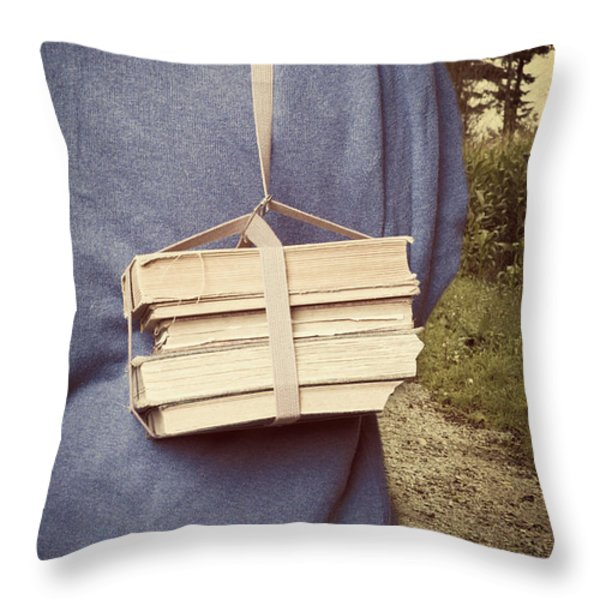 Teen Boy's Back With Books Throw Pillow by Edward Fielding