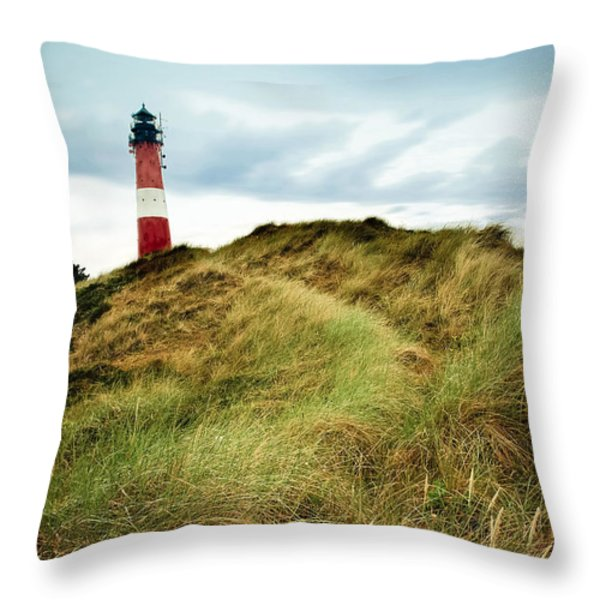 the lighthouse of Hoernum Throw Pillow by Hannes Cmarits
