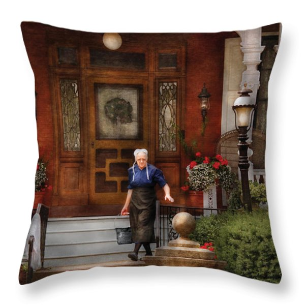 The Maid Throw Pillow by Mike Savad