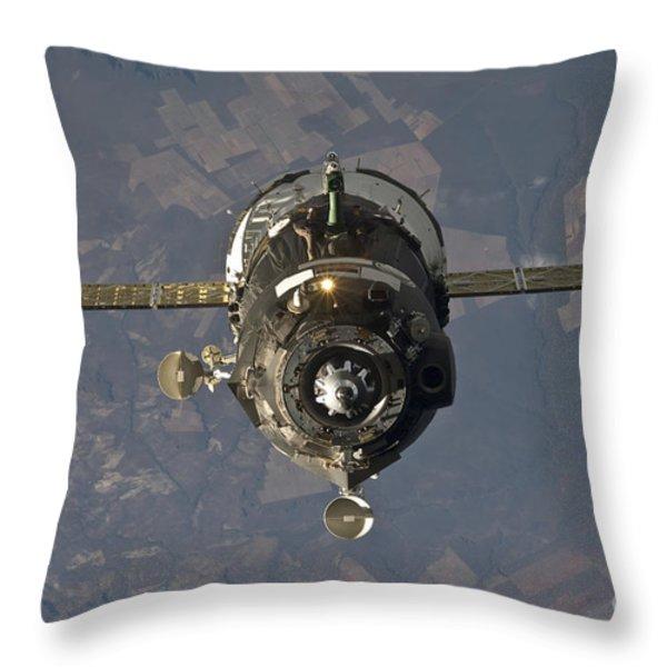 The Soyuz Tma-19 Spacecraft Throw Pillow by Stocktrek Images