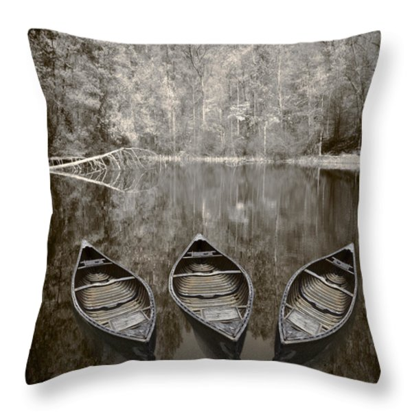 Three Old Canoes Throw Pillow by Debra and Dave Vanderlaan