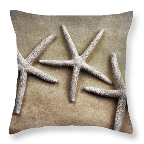 Three Starfish Throw Pillow by Carol Leigh