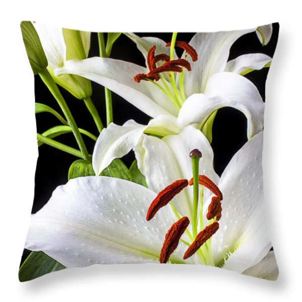 Three white lilies Throw Pillow by Garry Gay