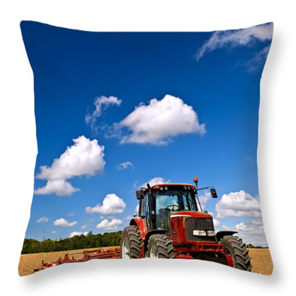 Tractor in plowed field Throw Pillow by Elena Elisseeva