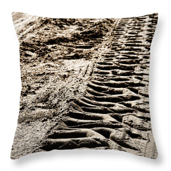 Tractor Tracks In Dry Mud Throw Pillow by Olivier Le Queinec