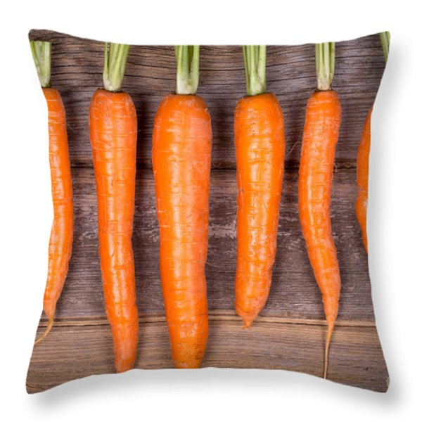 Trimmed Carrots In A Row Throw Pillow by Jane Rix