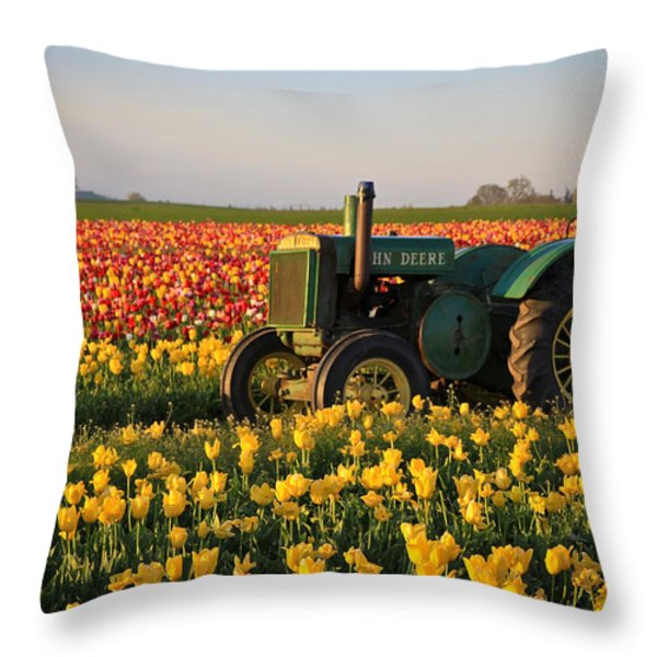 Tulips And Tractors Throw Pillow by Steve McKinzie
