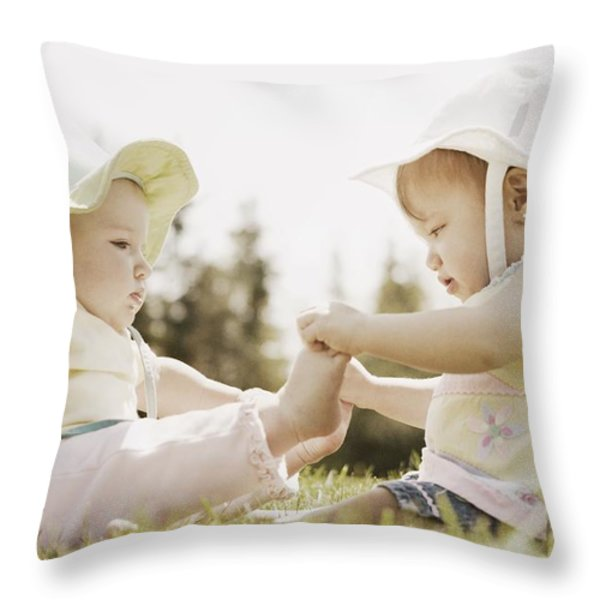 Two Girls Sit Together Throw Pillow by Don Hammond