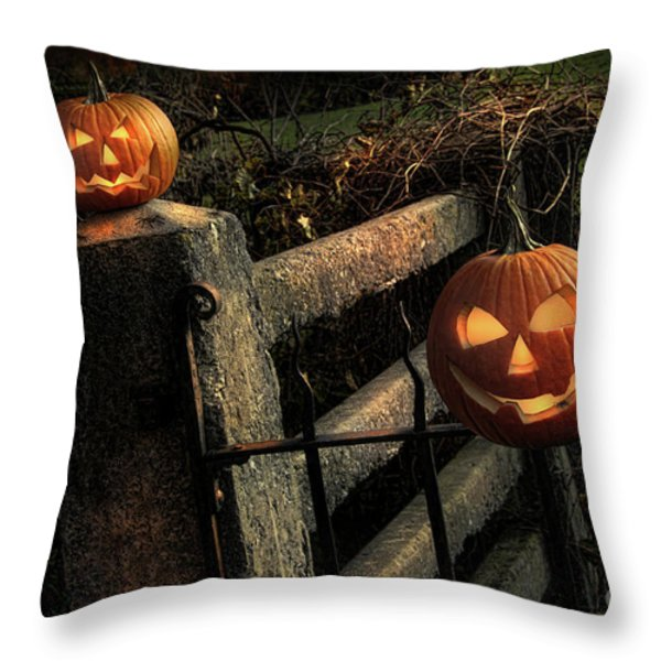 Two halloween pumpkins sitting on fence Throw Pillow by Sandra Cunningham