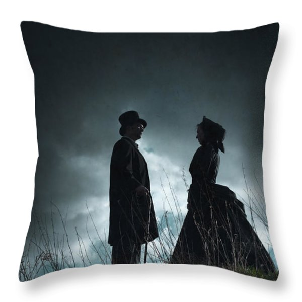 victorian couple face on another before a stormy sky Throw Pillow by Lee Avison
