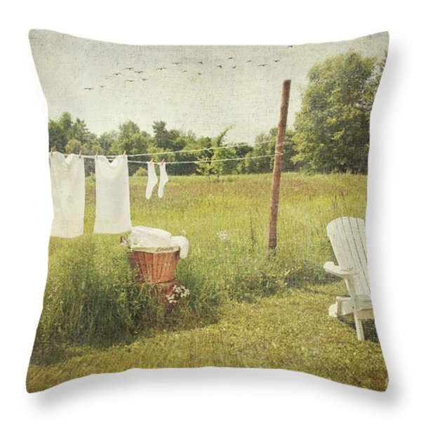 White cotton clothes drying on a wash line  Throw Pillow by Sandra Cunningham