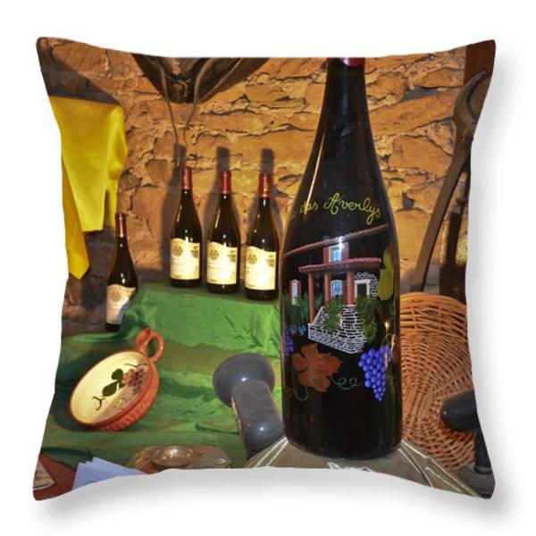 Wine Bottle On Display Throw Pillow by Allen Sheffield