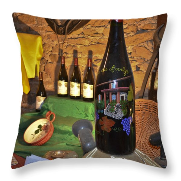 Wine Bottle on Display Throw Pillow by Allen Sheffield