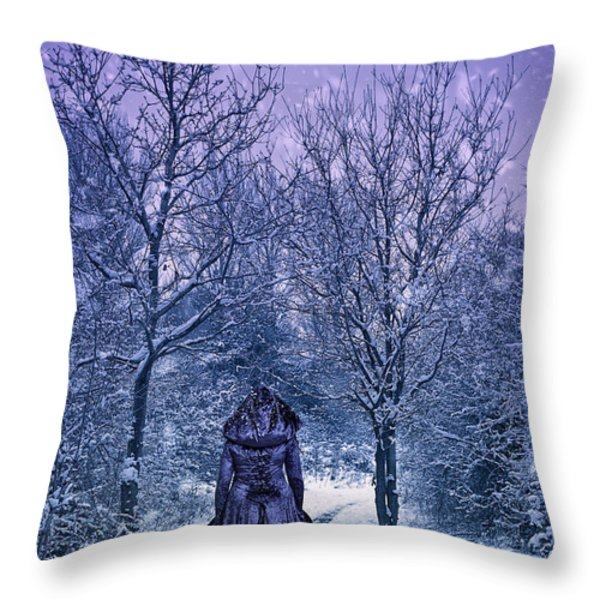 Woman Walking In Snow Throw Pillow by Amanda And Christopher Elwell