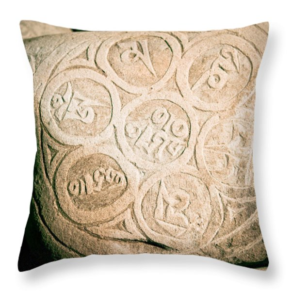 writing on the Tibetan language and Sanskrit at stone Throw Pillow by Raimond Klavins