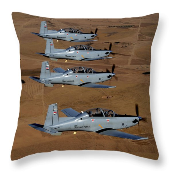 A Formation Of Iraqi Air Force T-6 Throw Pillow by Stocktrek Images