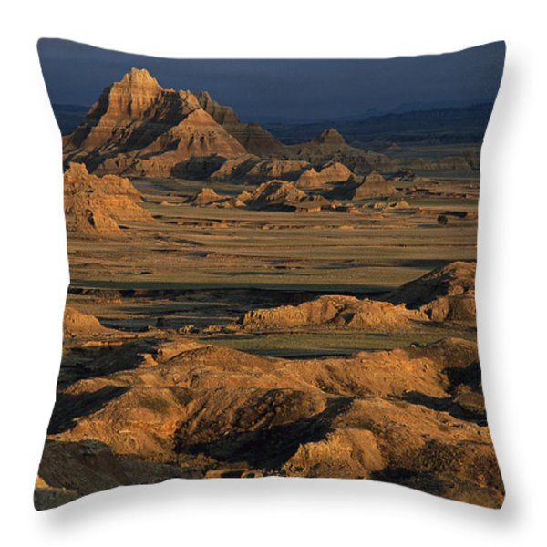 A Landscape Of Isolated Buttes And Rock Throw Pillow by Annie Griffiths
