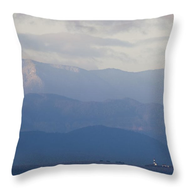 A Lighthouse At Sunset With The Olympic Throw Pillow by Taylor S. Kennedy