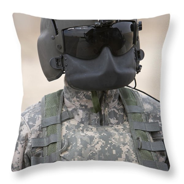 A Uh-60 Black Hawk Helicopter Crew Throw Pillow by Terry Moore