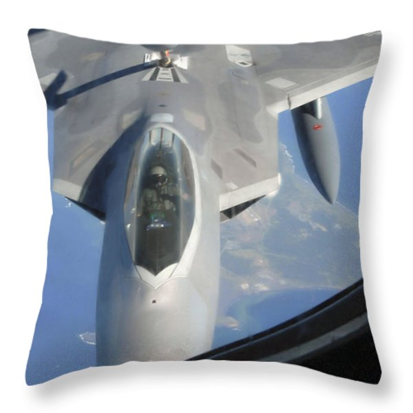 An F-22 Raptor Receives Fuel Throw Pillow by Stocktrek Images