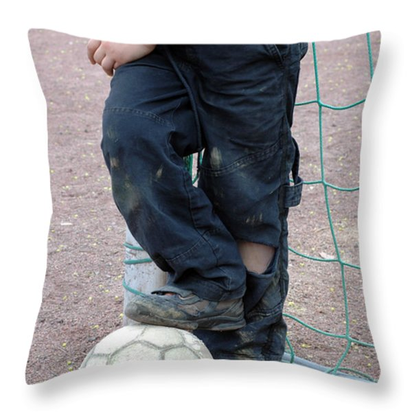 Boy With Soccer Ball Throw Pillow by Matthias Hauser